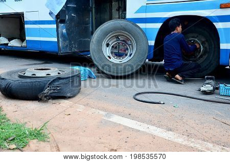 Thai Mechanic People Repairing And Fix Change Wheel Tire Of Bus Broken And Explosion On The Road