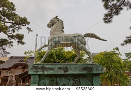 OKAZAKI JAPAN - MAY 31 2017: Statue of a horse in Tatsuki Shinto Shrine of Okazaki Castle Japan. Shrine is dedicated to deified shogun Tokugawa Ieyasu who was born in Okazaki castle