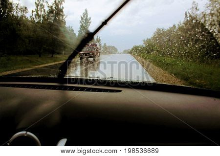 Windshield wipers working during the heavy rain.