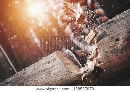 Close-up, Lumberjack Cuts A Big Tree In The Wood With A Sharp Ax, The Chips Splinter In Different Di