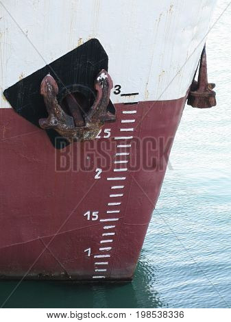 Waterline marked on the ship with draft scale numbering