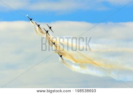 Aerobatic Team Aircraft Fighters Trail Of Smoke In The Sky