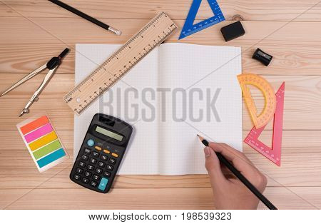 Math School Supplies On Wooden Table In Math Class. School Concept Advertisment With Math Equipment