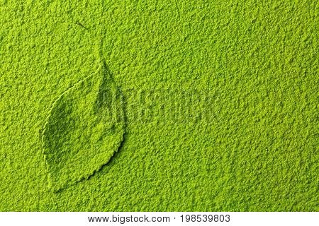 green matcha tea powder background with tea leaf top view from above