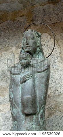 Statue of the Holy Virgin Mary with Jesus child in arm in a rock chapel