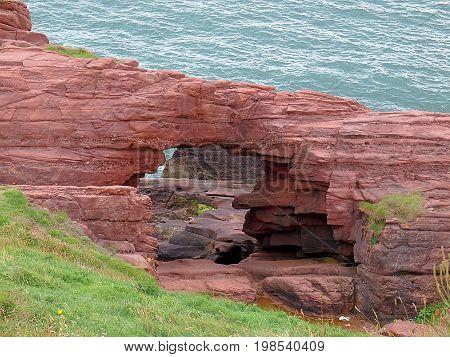 Unique cliffs in Arbroaht. Arbroath, Scotland - July 30, 2017 Natural cliffs in Arbroath, Scotland, on the North Sea.
