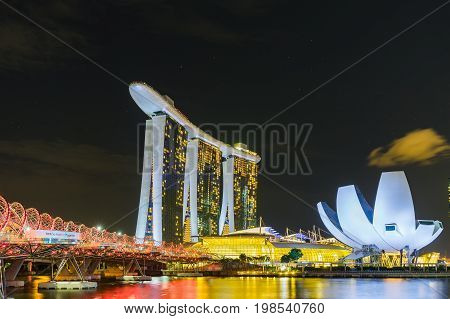 Singapore - August 1 2017: Night scene of Marina Bay Sands Hotel and The Lotus Shaped ArtScience Museum with illuminated lighting