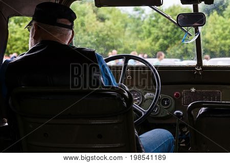 PAAREN IM GLIEN GERMANY - MAY 23 2015: The driver in the cab of a vintage car. The oldtimer show in MAFZ.