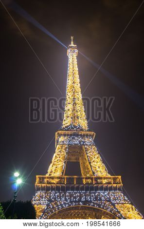 PARIS, FRANCE - OCTOBER 11, 2015: The Eiffel Tower is a wrought iron lattice tower on the Champ de Mars in Paris France