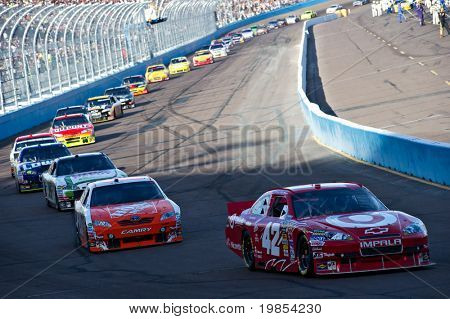 AVONDALE, AZ - APRIL 10: Juan Pablo Montoya (#42) leads a line of cars during a yellow caution flag at the Subway Fresh Fit 600 NASCAR Sprint Cup race on April 10, 2010 in Avondale, AZ.