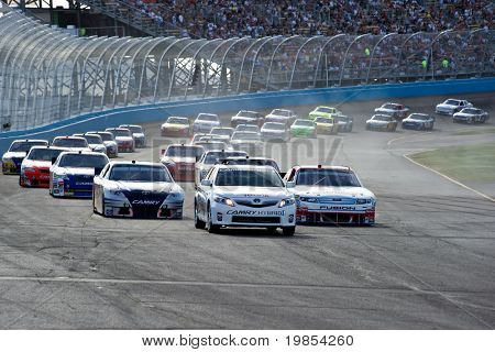 AVONDALE, AZ - APRIL 10: The pace car leads a group of cars out of turn two at the Subway Fresh Fit 600 NASCAR Sprint Cup race on April 10, 2010 in Avondale, AZ.