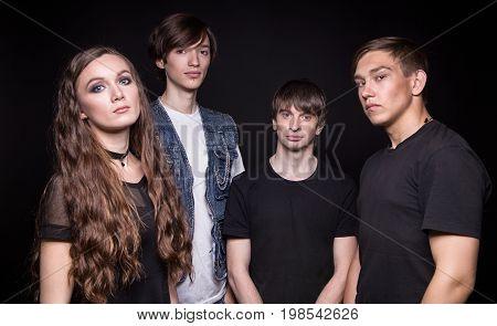 Photo of rock music band on black background