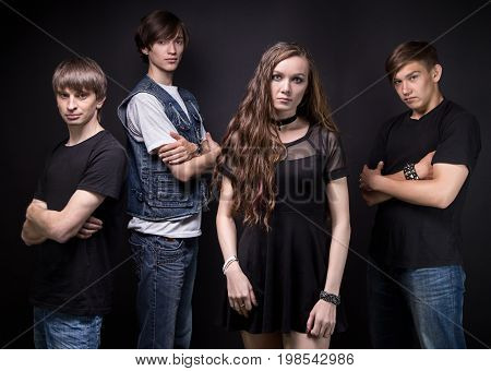 Photo of rock band - woman and men on black background