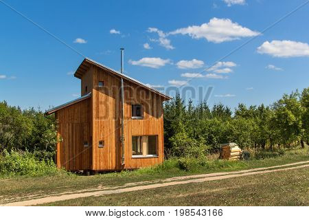 Eco-friendly wood-house at the woods. Energy saving. Living in nature. Wooden building