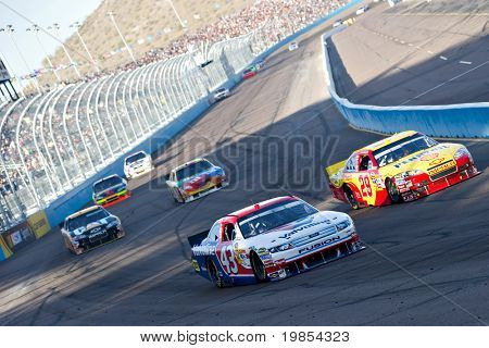 AVONDALE, AZ - APRIL 10: A.J. Allmendinger (#43) and Kevin Harvick (#29) lead a group of cars into turn one at the Subway Fresh Fit 600 NASCAR Sprint Cup race on April 10, 2010 in Avondale, AZ.