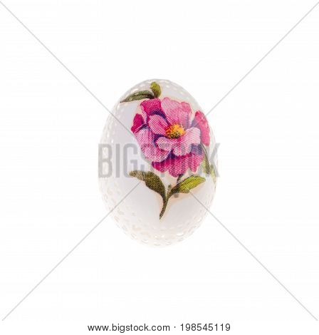 Easter hen's egg with carving. Macro. Isolated on a white background.