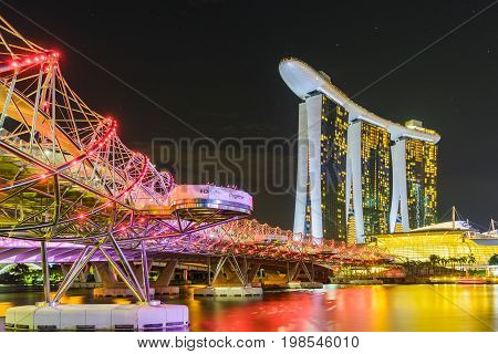 Singapore - August 1 2017: Night scene of Marina Bay Sands Hotel and Helix Bridge with illuminated lighting