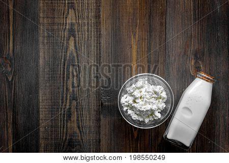 Non GMO, prservatives-free organic food on dark wooden background top view.