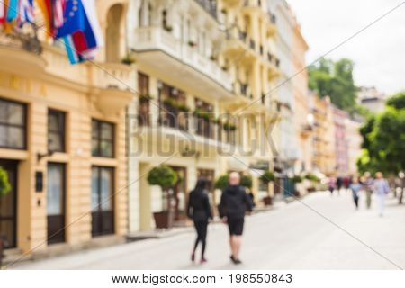 Blurred background photo.Cityscape bokeh. Defocused abstract city. Background out of focus.Can use as wallpaper, design. Summer blurry city backdrop.Travel out of focus photos