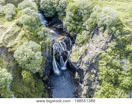 Aerial of the beautiful Lealt Falls - Isle of Skye - Scotland, United Kingdome