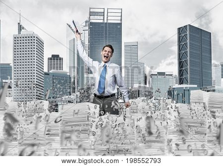 Young businessman keeping hand with book up while standing among flying letters with cityscape on background. Mixed media.