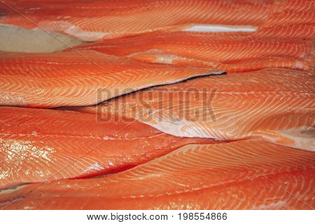 fresh uncooked red fish fillet close up. Fish background and wallpaper. The texture of the salmon fillet