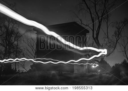 Light trails at night with fog and stars