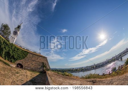 NOVI SAD SERBIA - JULY 30 2017: 4K footage with panoramic view of Petrovaradin Fortress and Danube river from fortress height in Novi Sad Serbia.