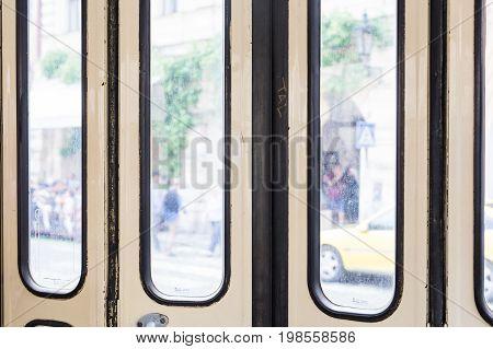 Closed entrance door in tram. Doors of old czech tram