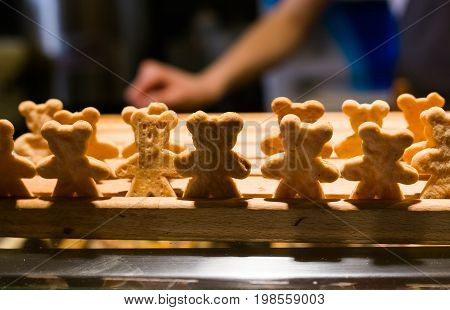 Lots of homemade little cookies in shape of bears in the bakery.