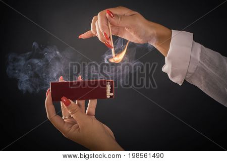 Womens Hands Ignite Big Matches For A Tompus Cigare Or A Fireplace