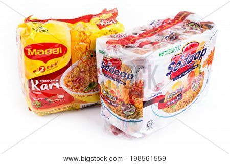 Selangor Malaysia: August 4 2017 - Malaysia famous instant noodles Maggi curry flavour and Mi Sedaap fried noodle on white background.