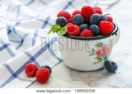 Mug With Fresh Berries.