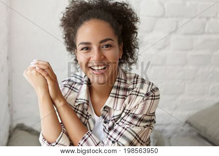 Portrait Of Cheerful Beautiful Woman With Dark Skin And Afro Hairstyle Wearing Checkered Shirt Smili