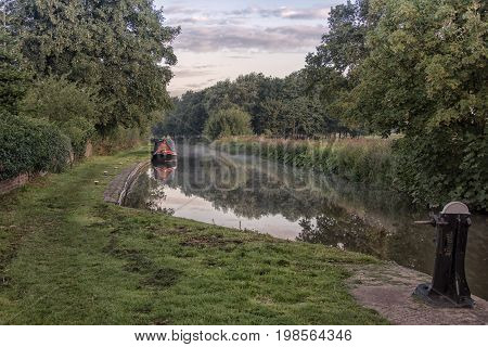 Early morning mist over the Trent and Mersey canal with reflections in the water