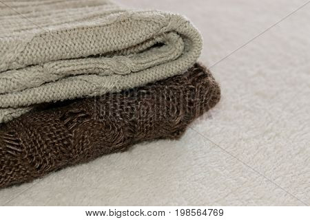 Stack Of Cozy Knitted Warm Sweater On Your Home Background . Sweaters In Retro Style. The Concept Of