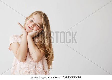 Portrait of a chuckling curious little girl