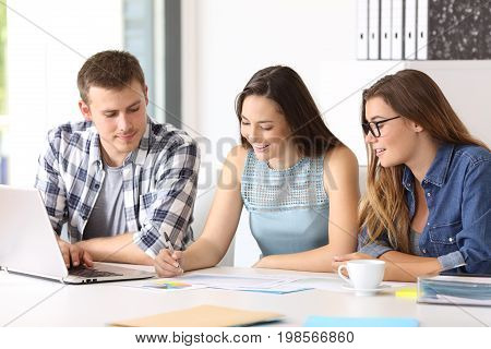 Three happy employees coworking reading documents at office