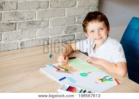 Child Drawing Picture Of Boy Going To School.