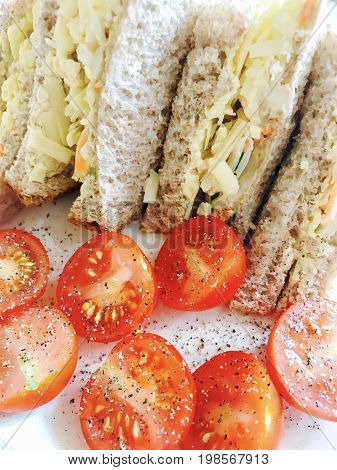 Cheese sandwich on brown bread with tomatoes