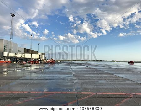 COPENHAGEN - AUGUST 3, 2017: Ground vehicles on the apron at Kastrup Airport in Copenhagen, Denmark.