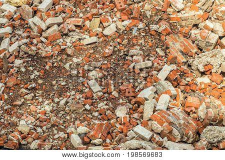 Destroyed red brick building wall. Broken brick.