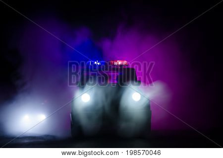 Speed Lighting Of Police Car In The Night On The Road. Police Cars On Road Moving With Fog. Selectiv