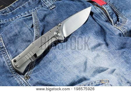 Folding Knife With Aluminum Handle. Knife In The Unfolded Position. Back Side.