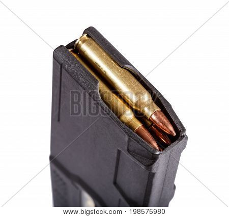 Gun magazin with ammo isolate on white. Macro photo