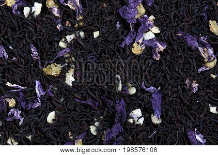 Tea mix of mallow petals, almond, chocolate flavor. Macro photo