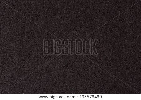 Gray paper texture close-up. High resolution natural macro photo.