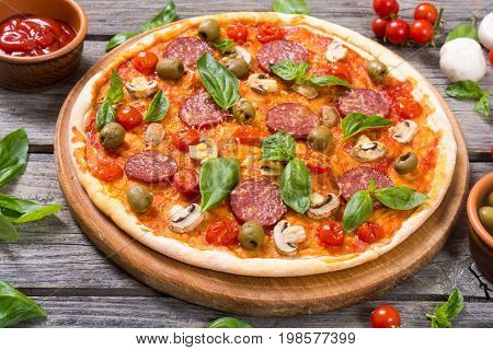 Italian pizza and ingridiend fod baking on table