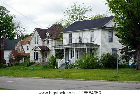 CADILLAC, MICHIGAN / UNITED STATES -  MAY 31, 2017: Historic single family homes in Cadillac's Courthouse Hill Historic District.