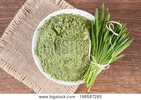 Barley Grass And Heap Of Young Powder Barley In Bowl, Body Detox Concept